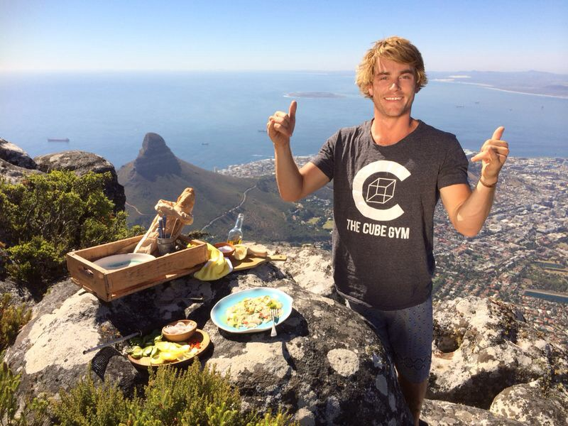 Hayden Quinn standing at the top of Table Mountain, having prepared his Yellowtail Crudo meal.