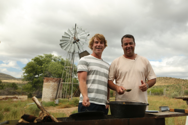 Hennie and Hayden standing in front of a windpump