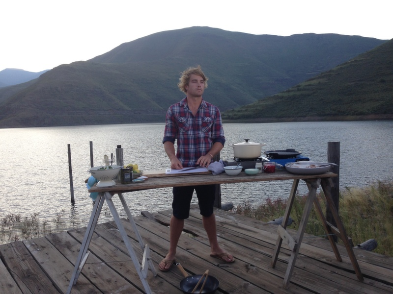 Hayden cooking on a jetty, on the banks of the Katse Dam
