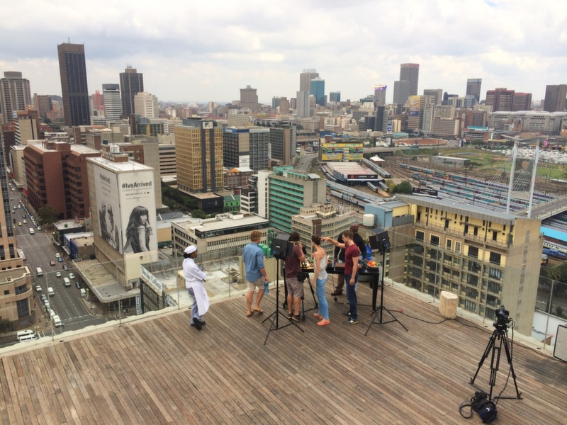 Hayden cooking on top of the Randlord's building in Jozi